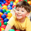 Boy in balls — Stock Photo