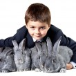 Lad with rabbits — Stock Photo #11312557