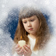 Girl with candle — Stock Photo