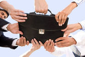 Holding briefcase — Stock Photo