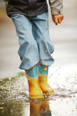 Running down puddles — Stock Photo