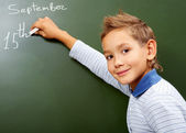 Boy at blackboard — Stock Photo