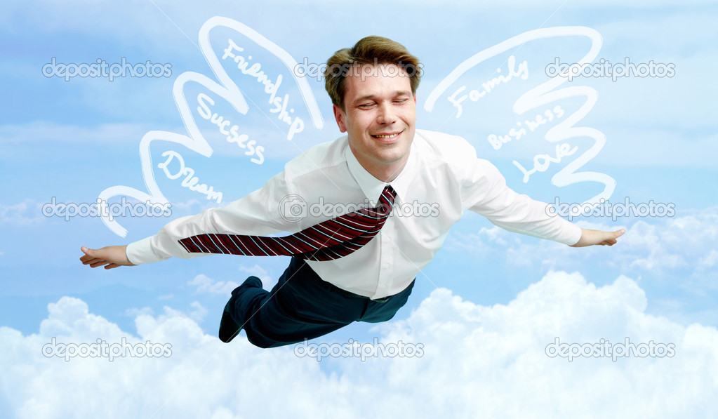 Conceptual image of smiling businessman with wings flying in the clouds  Stock Photo #11311198