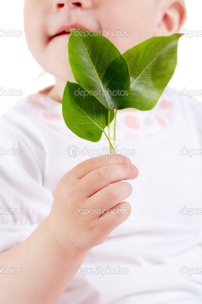 Conceptual image of innocent child holding fresh green leaves — Stock Photo #11312264