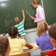 By the blackboard - Stock Photo