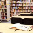 Workplace in library — Stock Photo
