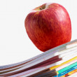 Red apple on copybooks — Stock Photo