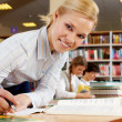 Working in library — Stock Photo