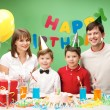 Stock Photo: Family during birthday