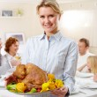 Woman with turkey — Stock Photo