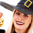 Royalty-Free Stock Photo: Witch with pumpkin candle