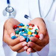 Handful of pills - Stock Photo