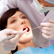 Examining oral cavity - Stock Photo