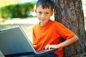 Boy with laptop — Stock Photo