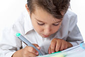 Close-up of school boy drawing picture on paper — Stock Photo