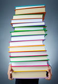Holding books — Stock Photo