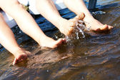 Legs splashing water — Stock Photo