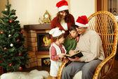 Reading Christmas tales — Stock Photo