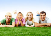 Family on lawn — Stock Photo