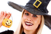 Witch with pumpkin candle — Stock Photo