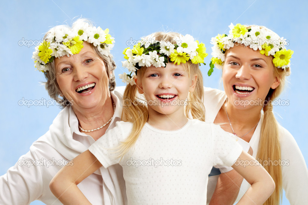 Portrait of grandmother and mother behind smiling girl — Stock Photo #11336122