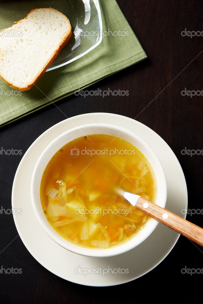 Dinner: bowl of tasty soup with bread near by — Stock Photo #11336942