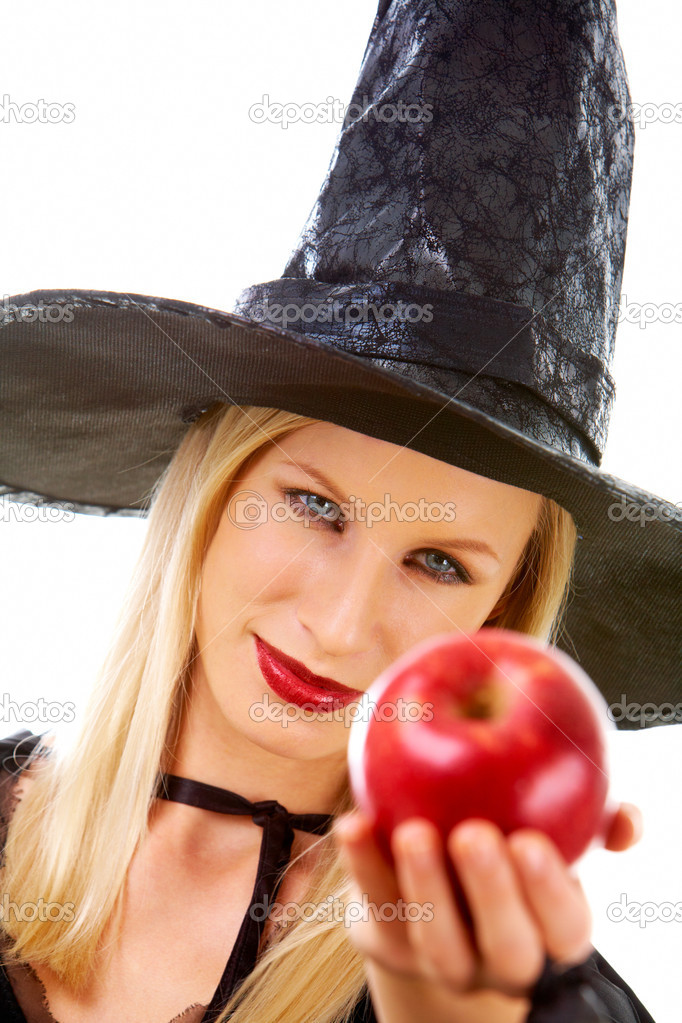 Image of witch giving red ripe apple to somebody — Stock Photo #11337310