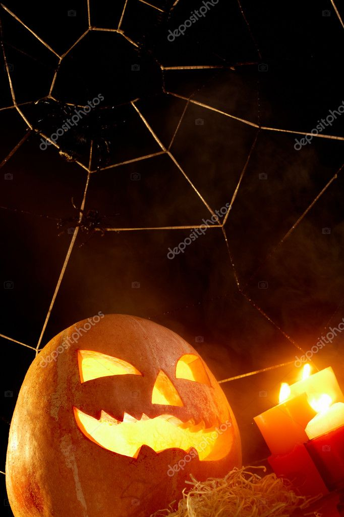 Image of Halloween pumpkin with burning candles and cobweb with spiders near by — Stock Photo #11337378