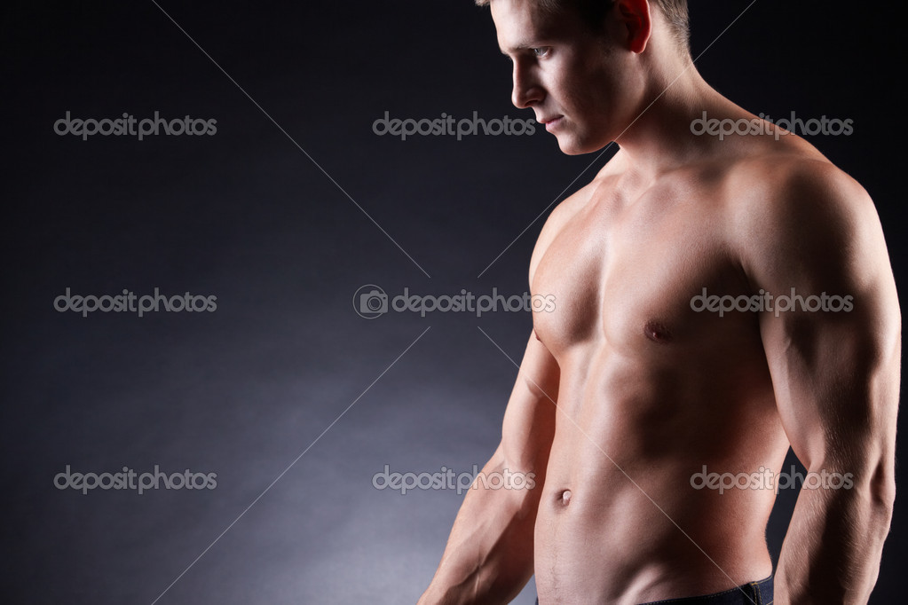 Image of shirtless man over dark background  Stock Photo #11337885