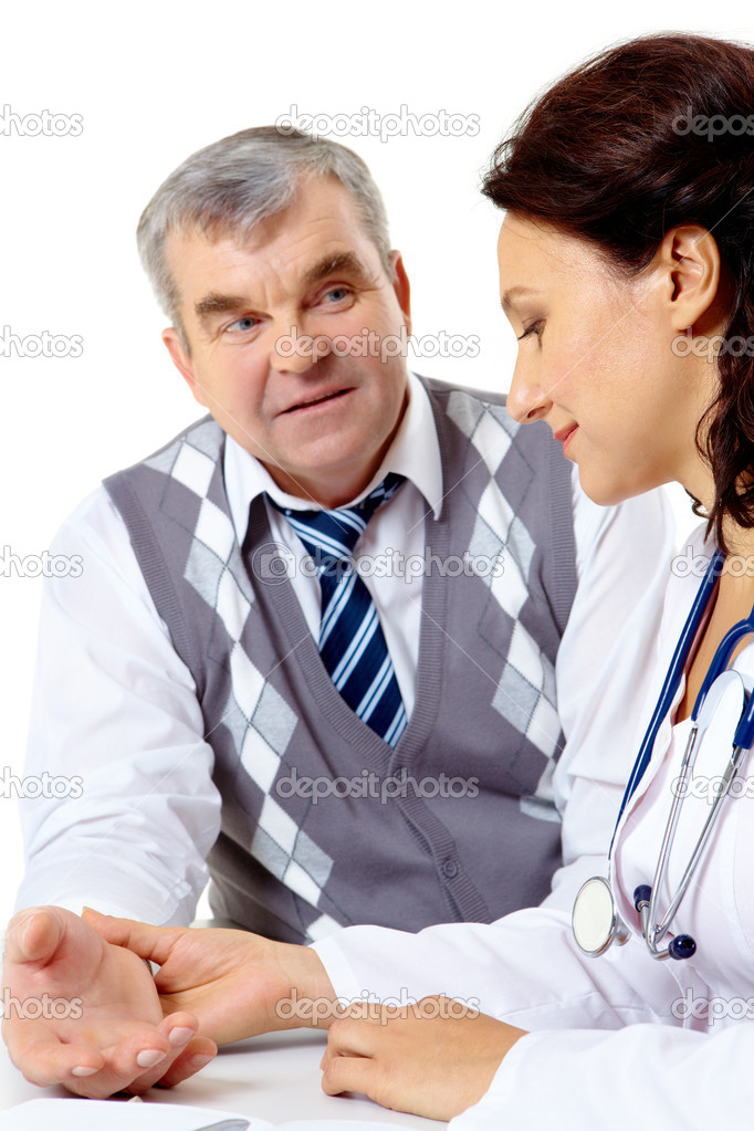 Portrait of friendly therapist checking patient pulse during medical consultation — Stock Photo #11338215