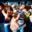 Photo of friends showing thumbs up meaning cool party — Stock Photo #11340742