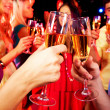 Clinking glasses with champagne — Stock Photo