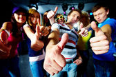 Photo of friends showing thumbs up meaning cool party — Stock Photo