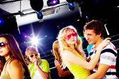 Friends clubbing — Stock Photo