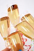 Sakiewkach brzęczały szampanów — Zdjęcie stockowe