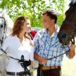 Stock Photo: Couple with horses