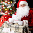 Santa reading letters — Stock Photo
