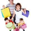 Family after shopping — Stock Photo #11582675