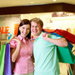 Couple of shopaholics — Stock Photo #11582692