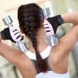 Stock Photo: Exercise with barbells