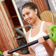 Stock Photo: Weight lifting