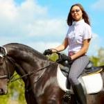 Girl on stallion — Stock Photo #11583916