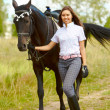 Brunette with horse - Stock Photo