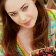Woman with berries — Stock Photo