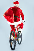Santa on bike — Stock Photo