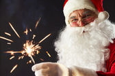 Santa with a sparkler — Stock Photo