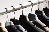Jackets on hangers — Stock Photo