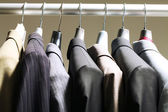 Jackets in wardrobe — Stock Photo
