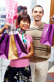 Couple of shoppers — Stock Photo