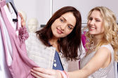 Shopaholics in clothing department — Stock Photo